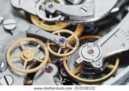Time concept. clock mechanism close-up view. Shallow DOF. - stock photo