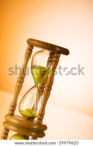 Time concept - hourglass against the gradient background - stock photo