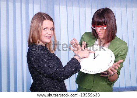 time concept in business with beautiful businesswoman and clock