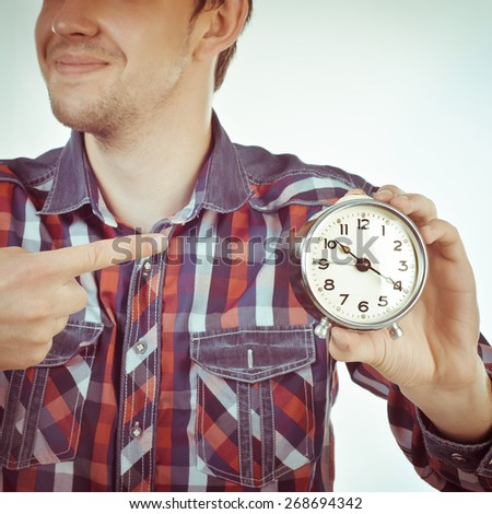time concept of man showing clock - stock photo