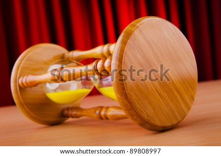 Time concept with hourglass - stock photo