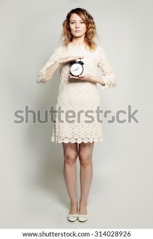 Time Concept. Woman and Alarm Clock - stock photo
