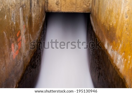 Time exposure of the spillway. - stock photo