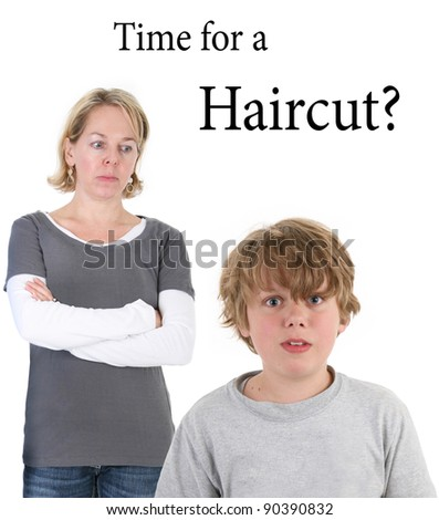 Time for a Haircut? Mother looking on at son with messy hair - stock photo
