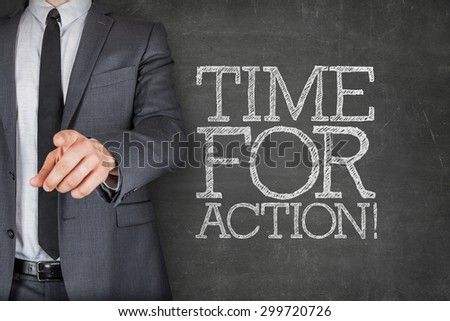 Time for action on blackboard with businessman finger pointing - stock photo