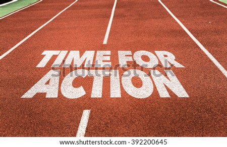 Time for Action written on running track