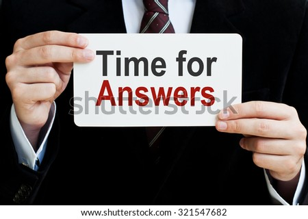 Time for Answers card in male hands - stock photo