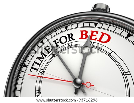 time for bed concept clock closeup isolated on white background with red and black words
