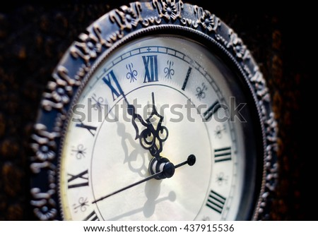 Time for change concept. Five minutes until twelve o'clock. - stock photo