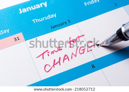 Time for change written on the calendar with a pen