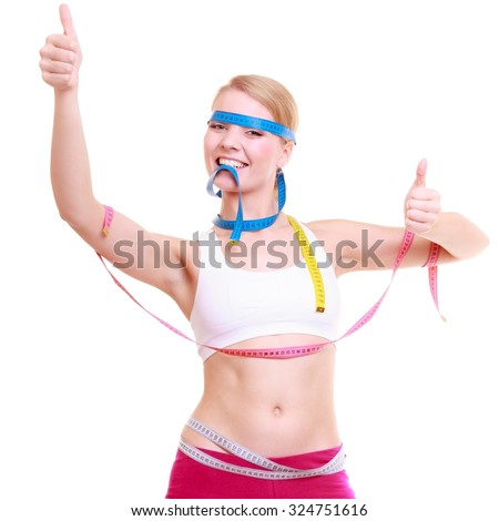 Time for diet slimming weight loss. Health care healthy lifestyle. Fit fitness woman with a lot of colorful measure tapes. Girl showing thumb up success hand sign. - stock photo