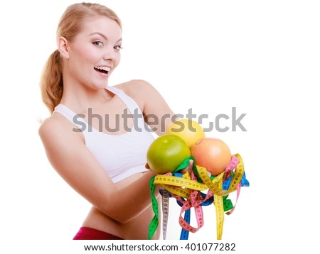 Time for diet slimming weight loss. Health care healthy lifestyle. Happy sport fit fitness woman blonde girl with a lot of colorful measure tapes and fruits isolated on white background - stock photo