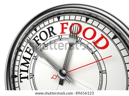time for food concept clock closeup on white background with red and black words
