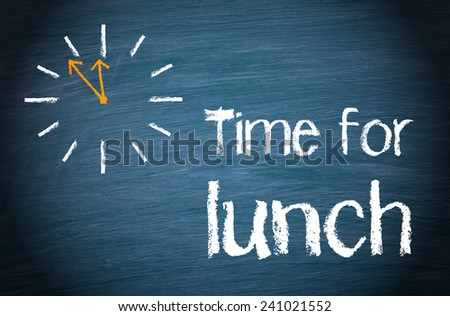 Time for Lunch - blue chalkboard with clock and text - stock photo