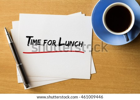 Time for lunch - handwriting on papers with cup of coffee and pen, concept