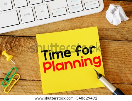 Time for planning/ Time for planning sticker with marketing plan inscription over computer keyboard
