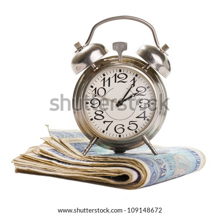 Time for profit. Retro alarm clock on a stack of banknotes isolated on white. - stock photo