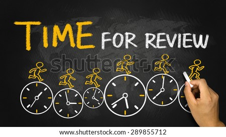 time for review concept on blackboard - stock photo