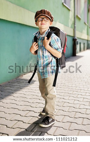 Time for school. Dreamy kid. - stock photo