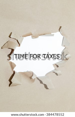 time for taxes written under torn paper. - stock photo