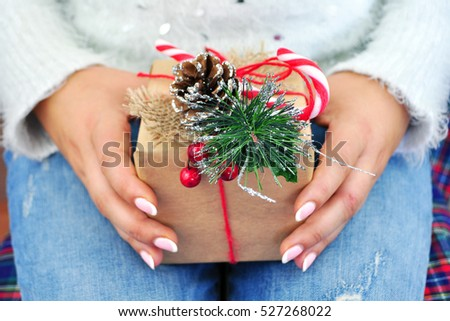 Time gifts - gift box in hand girl. Christmas background. Let it snow