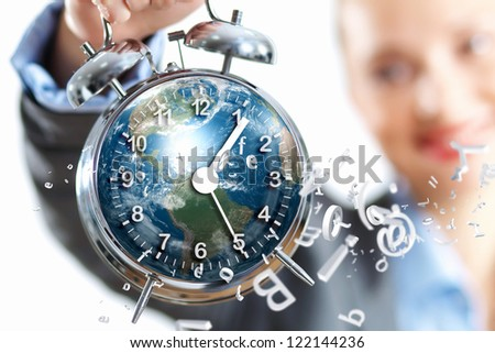 Time in business illustration with clock in hands of businesswoman. Elements of this image are furnished by NASA