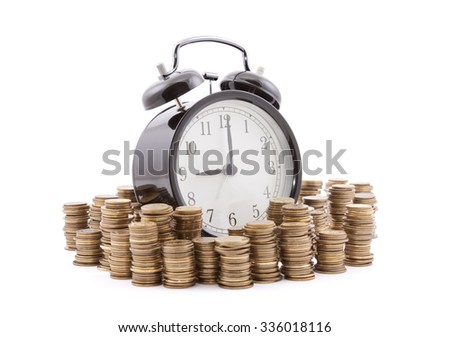 Time is money. Alarm clock with stacks of coins. Clipping path included.  - stock photo