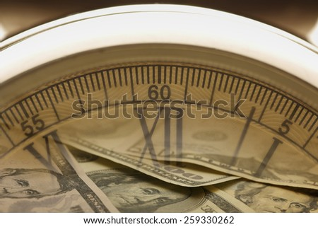 Time is money.  Clock in US dollars Clock, shot with very shallow depth of field  - stock photo