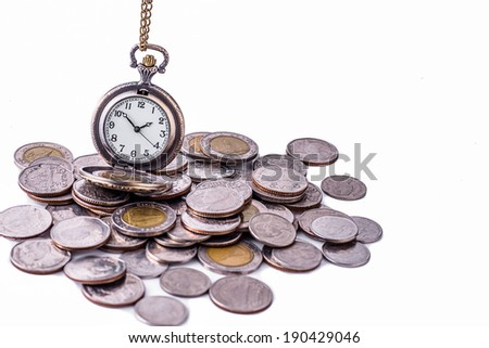 Time is money concept. Coins and an old pocket-watch. Selective focus. - stock photo