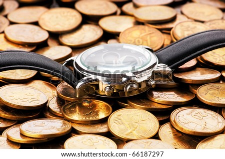 Time is money concept with watch and coins - stock photo