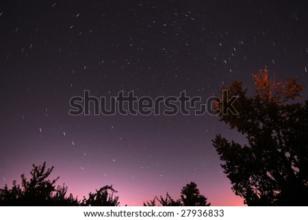 Time lapse image of stars rotating around Polaris; The North Star. - stock photo