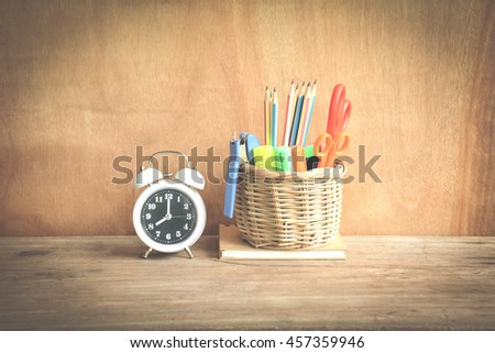 Time management concept:Alarm clock set at 8:00 and Writing in basket on book  - stock photo