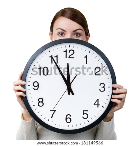 Time management for woman - concept. Woman with an office clock isolated on a white background