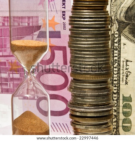 Time - money; hourglass on the background money. - stock photo