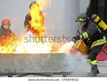 time of firemen during the exercise to extinguish a fire with foam