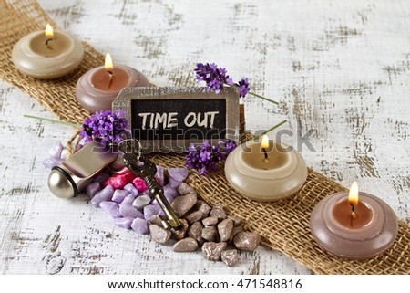 time out concept with burning candles and lavender