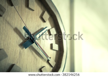 Time passing over the face of home office Wall Clock. Concept photo of time, timming,business, busy,deadline. - (Selective focus / Split tone) - stock photo