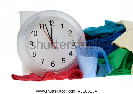 Time - Pile of dirty clothes for the laundry - isolated on white - stock photo