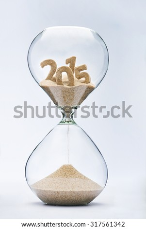 Time running out concept with hourglass falling sand from 2015 - stock photo