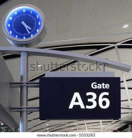 Time's inevitable passage is noted by a large clock - stock photo