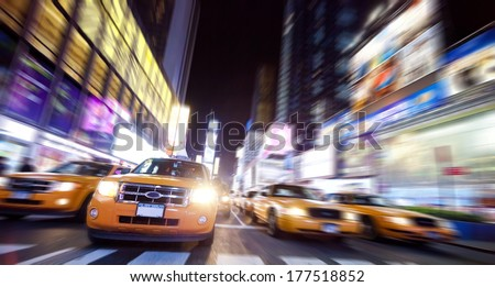 Time Square full of Taxi Cabs in the night - stock photo