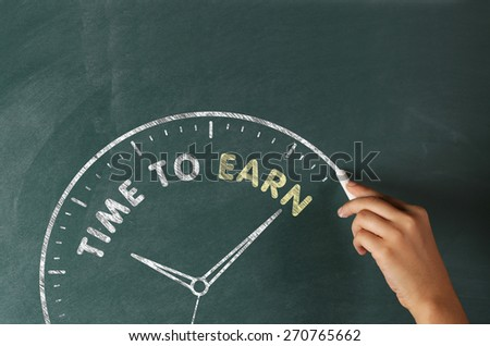 Time to Earn Concept on Blackboard - stock photo
