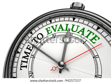 time to evaluate concept clock closeup isolated on white background with red and black words - stock photo