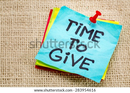 time to give - motivational reminder on a sticky note - stock photo