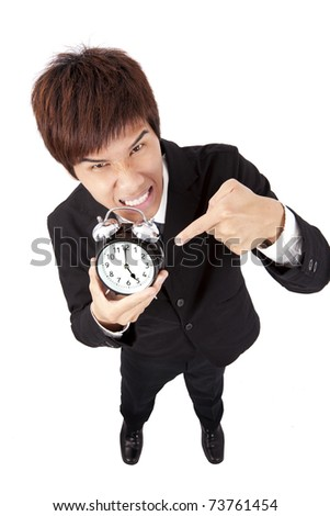 Time to go home.businessman holding a clock - stock photo