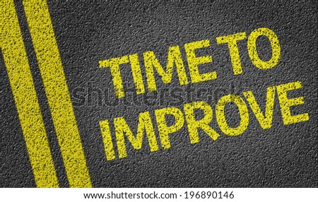 Time to Improve written on the road - stock photo