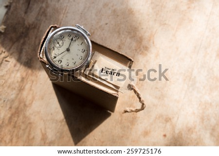 Time to Learn concept, retro wristwatch on a book. - stock photo