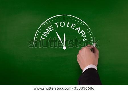 TIME TO LEARN word written by hand on blackboard - stock photo