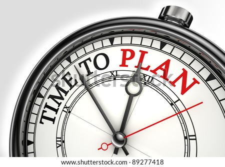 time to plan concept clock closeup on white background with red and black words