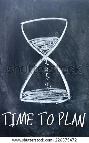 time to plan sign on blackboard - stock photo